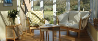 Semarang chair, sofa and tables, in bright conservatory, Fairtrade Conservatory Furniture