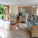 Jogya suite in modern garden room - Scala Jade and Linara Azure fabric